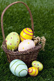 Easter basket and eggs Stock Images