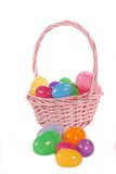 Easter Basket with Eggs. Pink Easter Basket with Multi-colored Eggs Stock Photos