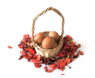 Easter basket with eggs. Small wicker basket with Easter eggs Royalty Free Stock Photography