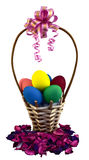 Easter basket with eggs. Easter wicker basket decorated pink ribbon full of eggs Stock Photo