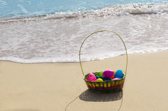 Easter basket with eggs on the beach Stock Photo