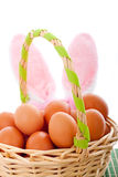 Easter basket with eggs and bunny ears Stock Photography