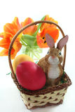 Easter basket with eggs and bunny and tulips Stock Photo
