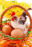 Easter basket  with eggs and  cock Royalty Free Stock Images