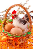 Easter basket  with eggs and  cock Royalty Free Stock Photos