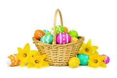 Easter basket with eggs and daffodils over white Royalty Free Stock Photo