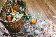Easter basket with eggs, easter bread,ham,sausage, butter with flowers and branches on cloth on rustic wooden background. Happy. Easter concept. Religious stock photos