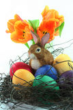 Easter basket with eggs and Easter bunny and tulip. Easter basket with Easter eggs and Easter bunny and tulips on a white background royalty free stock photos
