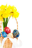 Easter basket with eggs and flowers Royalty Free Stock Photography