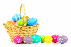 Easter basket with eggs over white Royalty Free Stock Image