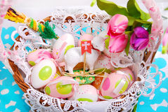 Easter basket with eggs and sheep figurine Stock Photos