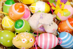 Easter basket with eggs and sheep figurine Royalty Free Stock Photo