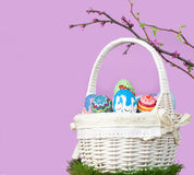 Easter basket with eggs and spring twigs Stock Photos