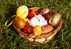 Easter basket with bunny and eggs on the grass Royalty Free Stock Image