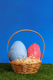 Easter basket on field stock photo