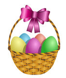 Easter Basket Filled with Colored Eggs Stock Photography