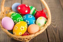 Easter basket filled with colorful eggs stock photography