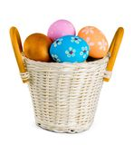 Easter basket filled with colorful eggs on a white royalty free stock image