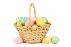 Easter basket filled with Easter Eggs over white Stock Image