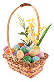 Easter Basket with floral arrangement. Easter basket with colorful eggs on white background Royalty Free Stock Image