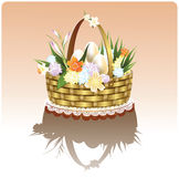 Easter basket with flowers. Easter basket with Easter eggs and flowers Royalty Free Stock Photography