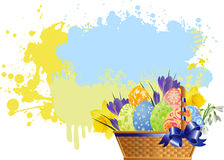 Easter basket with flowers and aggs. Stock Image