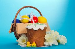 Easter basket and flowers Stock Photos