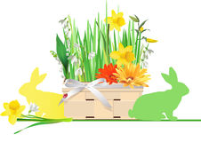 Easter basket with flowers and rabbits. Stock Photos