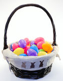 Easter basket full of assorted colored easter eggs stock image