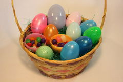 Easter basket full of colorful plastic eggs Royalty Free Stock Photos