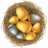 Easter basket with gold and silver eggs Stock Photos