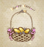 Easter basket with golden eggs Stock Image