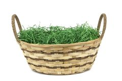 Easter basket with grass isolated on white background stock photos