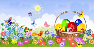Easter basket on the lawn Royalty Free Stock Photos
