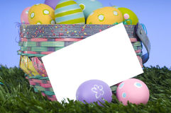 Easter Basket Notecard. A blank notecard or card with a overflowing basket of Easter eggs add message or graphics to copy space Stock Photo