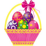 Easter basket with pink bow and a color eggs  Royalty Free Stock Images