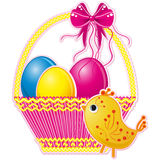 Easter basket with pink bow and a color eggs  Stock Photography