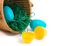 Easter basket with plastic eggs stock images