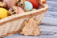 Easter basket and plywood rabbits. Stock Photos
