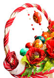 Easter basket with poppies and eggs isolated on white. Easter basket decorated with embroidery, poppies and colorful eggs isolated on white royalty free stock photos