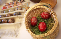 Easter basket with red eggs Royalty Free Stock Images
