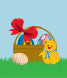 Easter. Basket with ribbon Image eggs on grass with chick Stock Photography
