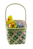 Easter Basket and Toy Duck. Decorated wicker Easter basket with a rubber duck and jelly beans, isolated Royalty Free Stock Image