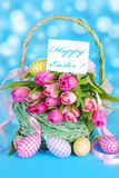 Easter basket with tulips and eggs Stock Photography