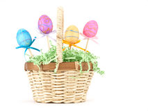 Easter Basket on White. Easter basket with colorful eggs on white with copy space Royalty Free Stock Photos