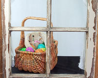 Easter Basket In A Window Royalty Free Stock Photos