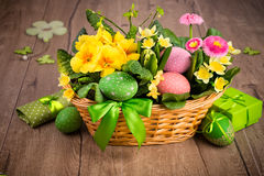 Easter basket on wood with handmade decorations Stock Photos
