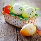 Easter basket on wooden board Stock Image
