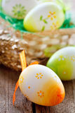 Easter basket on wooden board Royalty Free Stock Photo