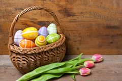 Easter basket on a wooden plank stock photography